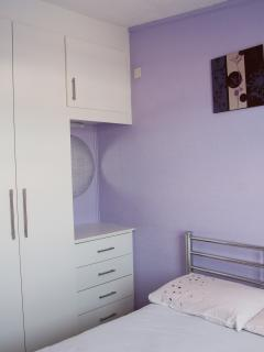 Double bedroom with fitted wardrobes and unit