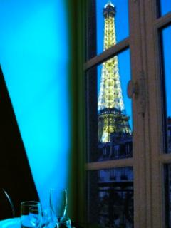 Above the typical Paris tin roofing the Eiffel Tower from dinner table