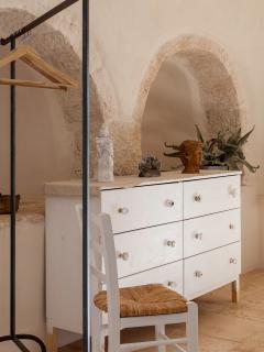 Original stone arches in the master bedroom