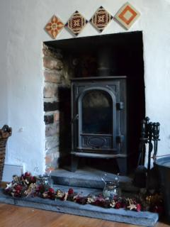 Snuggle up in front of a real fire in the wood burning stove