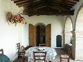 Your outdoor dining table beneath the classic Umbrian loggia