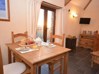 Dining area with patio doors to juliet balcony