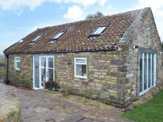 THE COWSHED, detached stone cottage with woodburning stove. Mostly ground floor. Patio with furniture, fire put and sea views, near Whitby, Ref 916824