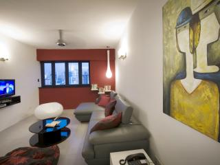 Funky furniture and big canvas paintings in living room
