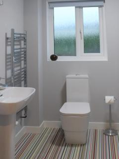 The ground floor bathroom and upstairs bathroom both have baths so no excuses kids!.