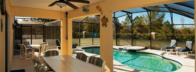 Dine al fresco under the covered lanai with its own fan to keep you cool