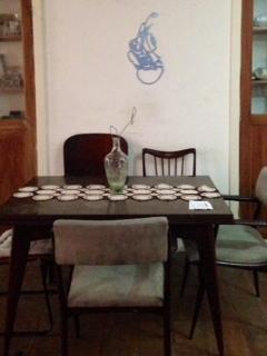 dinner table and pedro´s art on the wall