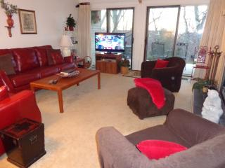 Here's your living room. Sliding doors open onto patio. New 42' Smart HD Flat Screen TV.
