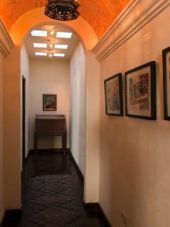 Vaulted ceiling hallway between guest bedroom and guest bathroom