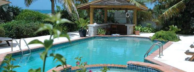 AVAILABLE CHRISTMAS & NEW YEARS: Anguilla Villa 109 Magnificent Freshwater Pool And Whirlpool With Waterfall Splash-over Rest Literally On The Rugged Coastline Of Anguilla.
