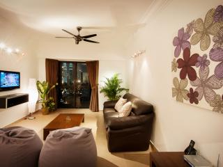 Cosy living room with leather sofa and big bean bags