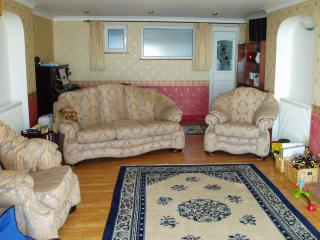 The spacious living room with piano behind. Television, Freeview, DVD, Wii and board games provided.