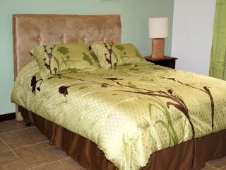 Each bedroom has a queen size bed.