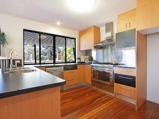 open plan kitchen and living area with under roof patio overlooking the sea.