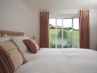 Double room at the back of the house with a king size bed and panoramic views to the estuary