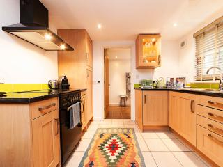 Full kitchen with gas cooker, incl microwave, kettle, toaster & nespresso coffee machine