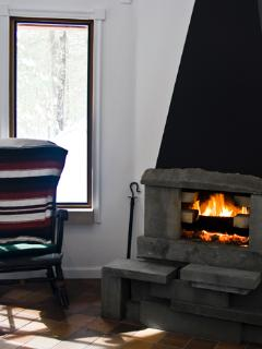 The stone and steel fireplace keeps things cozy and warm.