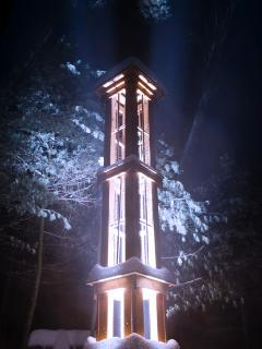 The light tower up close at midnight.