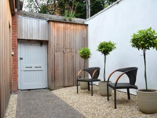 The enclosed front courtyard a separate seating space to the outdoor back garden