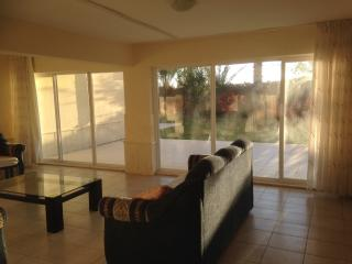 The second lounge area leading to patio