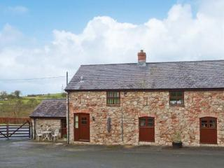 GRAIG FAWR COTTAGE, semi-detached, stone cottage with a multi-fuel stove, WiFi,