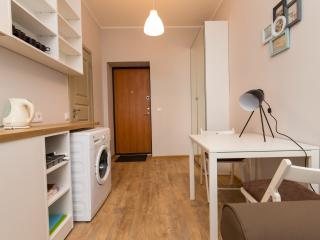 Exit door, Room overview, Washer, dining area, sofa, coffe/tea facilities, closed