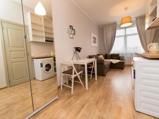 Closet, dining table, sofa, lamp, washer, coffe/tea facilities