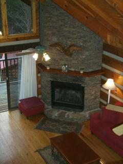 Stack stone fireplace in living room