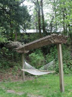 Relax to the sound of the river in the hammock