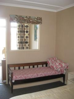 Day bed in main bedroom for children or short thin people!