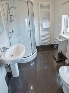 En-suite bathroom to Bedroom 4 one of 5 modern bathrooms at Marine Villa