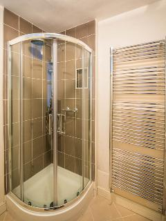Modern shower room with heated towel rail.
