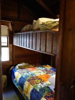 Bunk bed bedroom in cottage also has a 1/2 bathroom