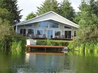 Newer ocean shores home, On the water