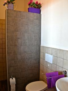 bathroom with shower in lava stone from the volcan Etna