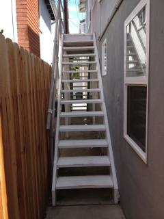 Stairs leading up to apartment entrance
