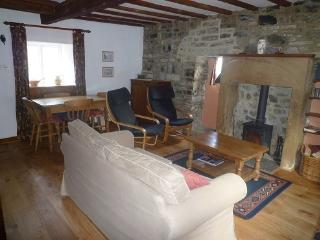 Living Room with woodburning stove, beams and exposed stonework