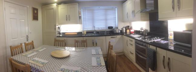 Kitchen has cupboards full of crockery, cutlery, ovenware, pans, glasses etc.