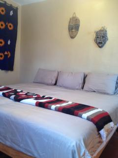 Bedroom 2, 1 King bed or 2 singles, bathroom, balcony, ac