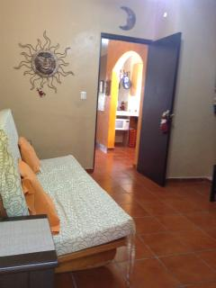Living room, featuring a futon, tv, dvd player, bathroom