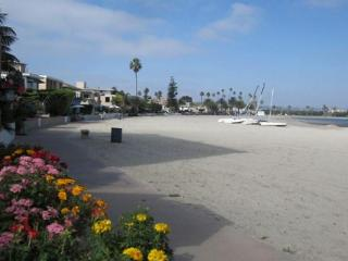 Third-floor condo steps from beach - comes w/ boogie boards. Enjoy rooftop patio