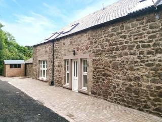 HAYLOFT HOUSE, mid-terrace, en-suite, woodburning stove, courtyard, in