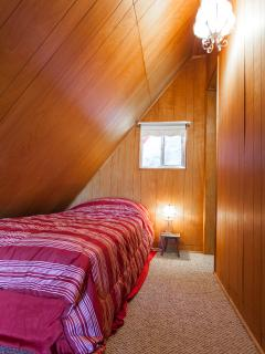 Loft Bedroom with single next to upstairs bathroom