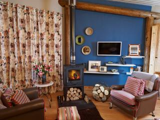 Living area with log burner and armchairs