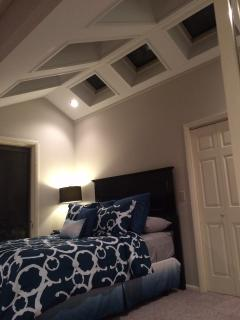 4th bedroom Upper level with cathedral ceilings and 6 skylights