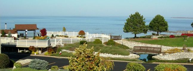 Lake front with  nice heated pool, hot tub and private sandy beach