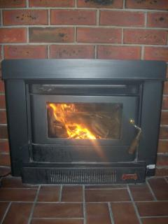 Cosy combustion wood heater in lounge room