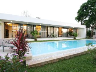 Set in exquisite tropical garden with a pristine pool.