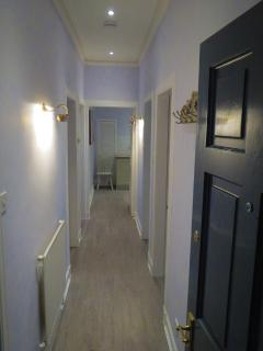 The main entrance and hallway with French grey walls and complimenting white washed flooring