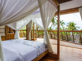 Master bedroom with king bed, adjoining bathroom and private terrace with sea view